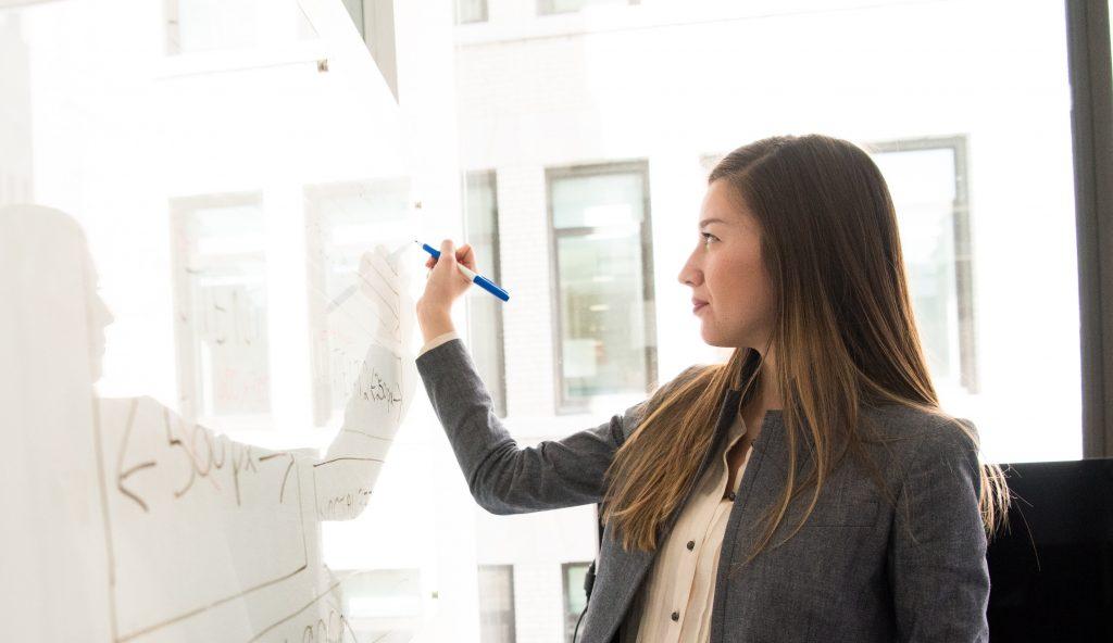 teacher writing on board, how education leaders motivate teachers